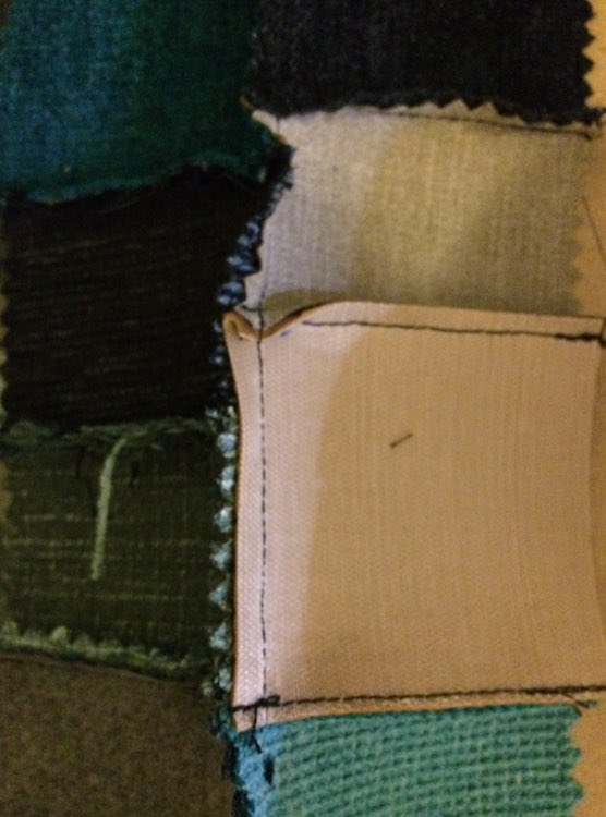 The back of the fabric samples after being sewn together.