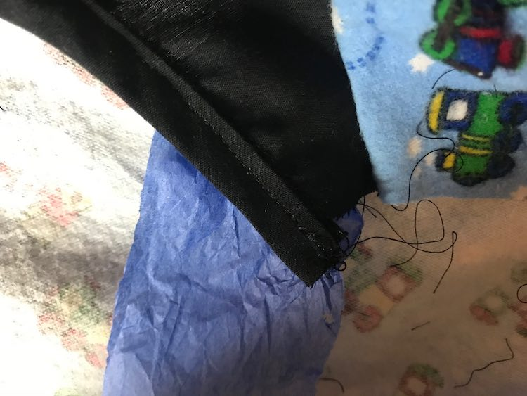 When the sewing machine tried to eat my fabric I used tissue paper to help it keep going... I've since tried not to do that as on Youtube video I watched asked what would happen if your machine got the tissue paper caught up inside it.
