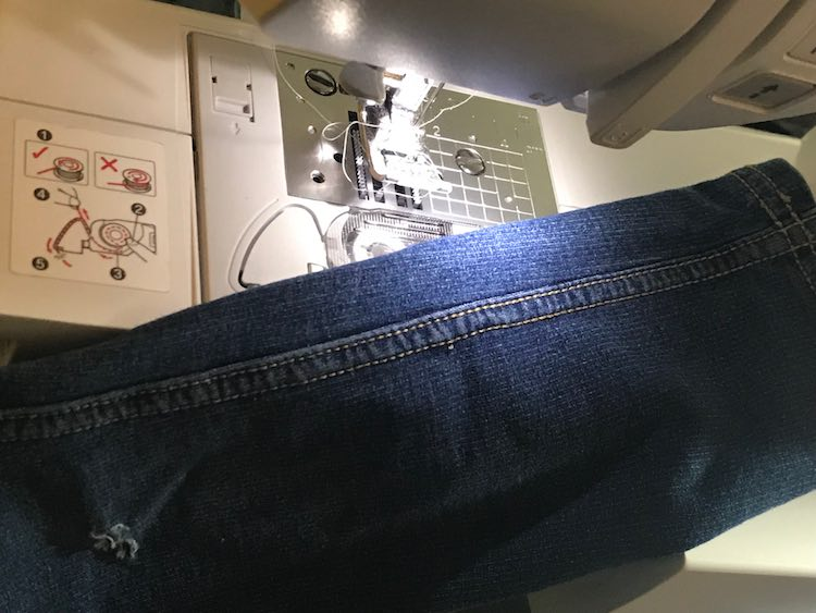 The legs are way too skinny to fit around my sewing machine so the only other option seemed to be to open up the seam to access the hole.