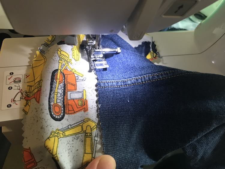 I then kept lining up the jeans as I sewed along making sure to cover up the construction vehicles above the main road.