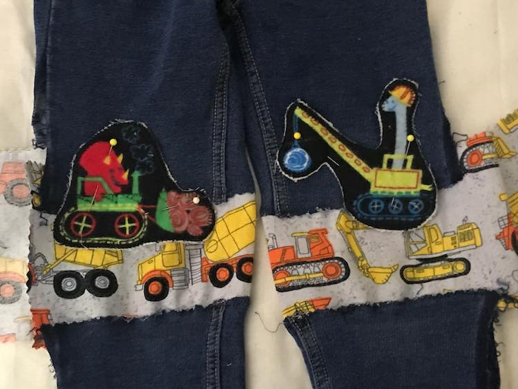 I then figured out where I wanted the two dinosaur riding construction trucks placed and pinned them down.