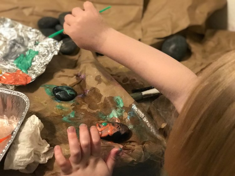 Painting her rocks.