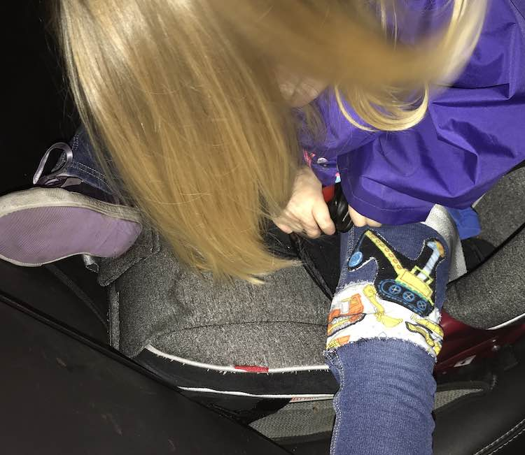 And closeup of the other leg while doing up her carseat.