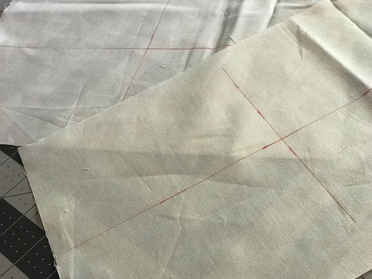 I started out by cutting out white cotton for the passport pockets and drew out my drawing boundaries with my ierase pen.
