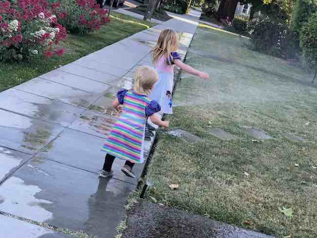 Playing in some sprinklers.