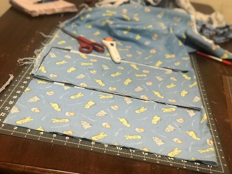 After folding the dinosaur fabric I cut it two long rectangles. Folded it was about 16 by 8 inches but unfolded about 32 inches long.