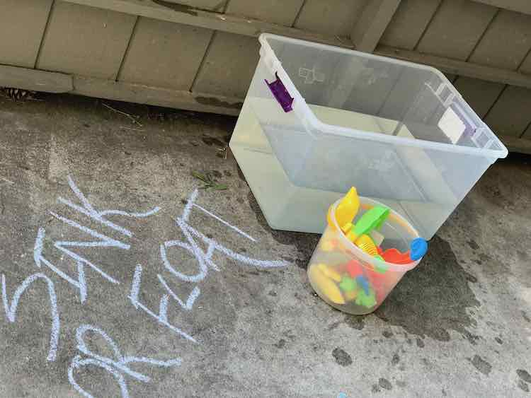 And the filled bin was placed with the toys. Just a heads up maybe move it with the lid on so it doesn't slosh over your living room on the way out the door. A garden hose would definitely make this easier.