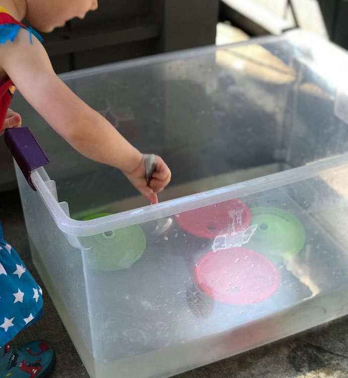 A bin of water can be handy to rinse off your toys and fingers.