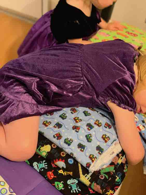 Once done Ada took the opportunity to hug the remaining fabric as Zoey continued to peruse the wares that remained.