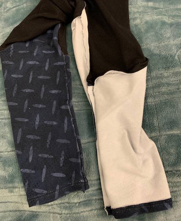 Closeup of the outside (left side) and inside (right) of the pants.