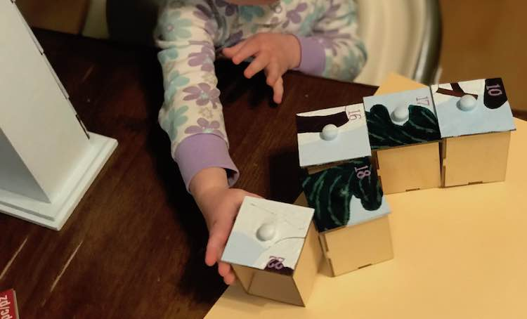 Zoey loved playing with the advent calendar as Ada was focused on the new item.