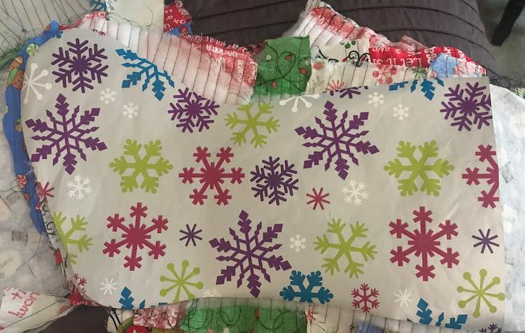 I followed the tutorial on Diary of a Quilter so I next pinned the top of each outer quilted stocking right sides together with the corresponding liner and sewed them together.
