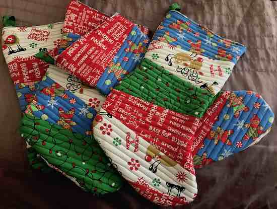 Four Christmas stockings made from the last fabric purchased.