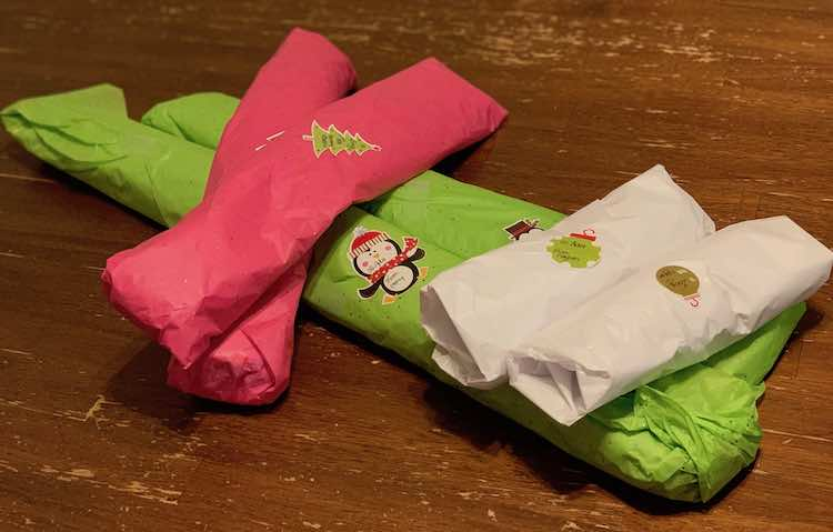 Garments all wrapped up to be enjoyed on our trip.