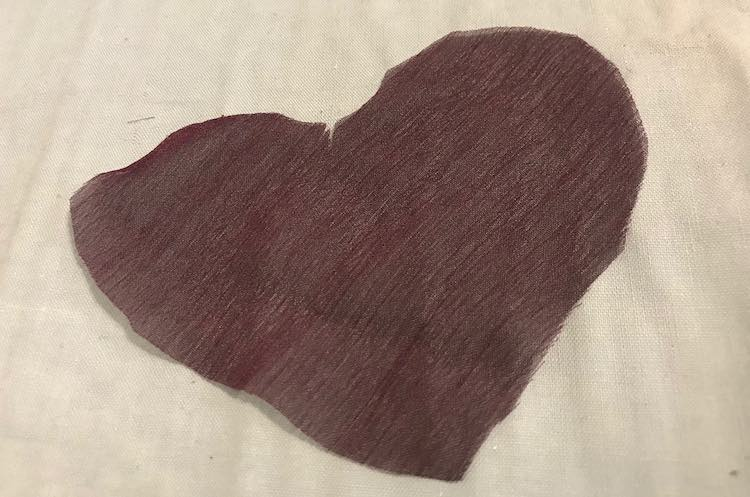 Purple heart cut out from the excess purple chiffon.