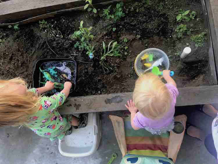 Ada and Zoey playing with the plain water pools.