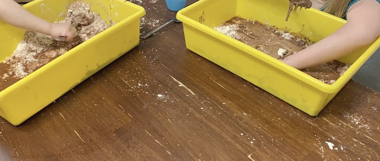 Playing in the oobleck bins.