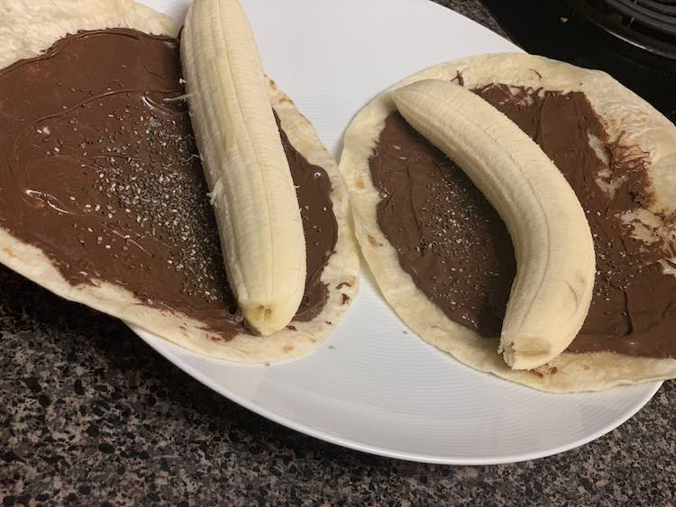 Tortilla, Nutella, chia seeds, and a banana all ready to be rolled.