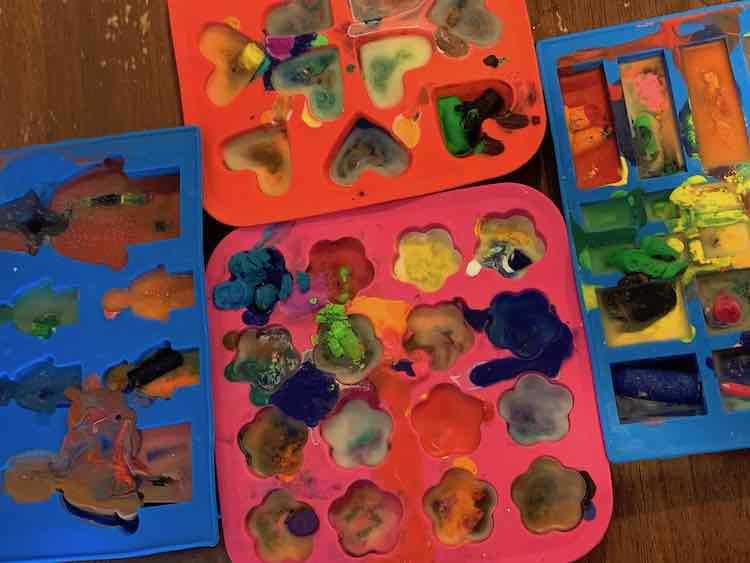 Filled, melted, and hardened crayons in the moulds.