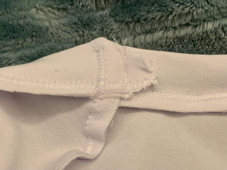 Underside of the neckband seam. Shows the excess seam allowance sewn down.