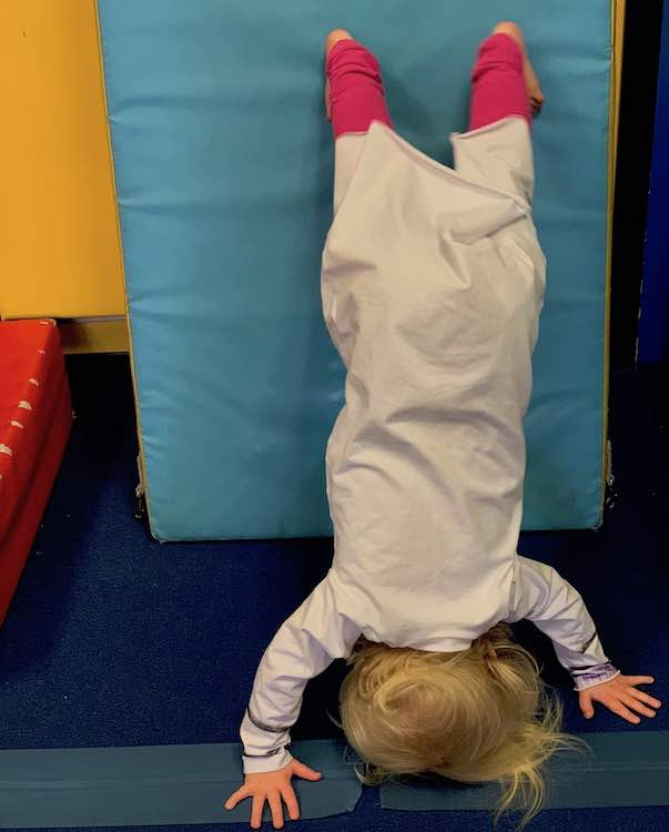 Zoey walked herself up into a leaning handstand while wearing the costume.