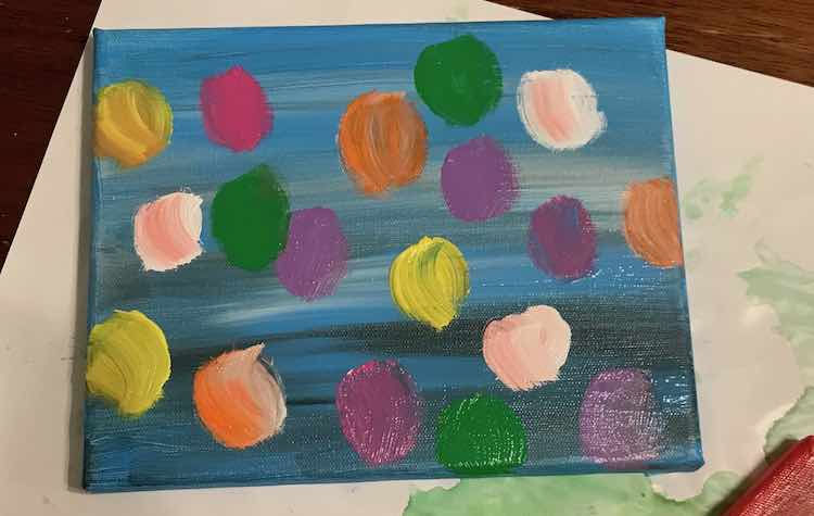 """Closeup showing the blue canvas with the painted balloons. Some of the balloons, in particular the orange one at the bottom near the left side, shows how I painted the balloons using two reversing """"C""""s."""