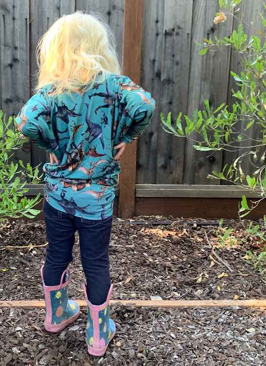 Back of the 'shirt'. Zoey has hands on hip, jeggings on, and insect rubber boots.