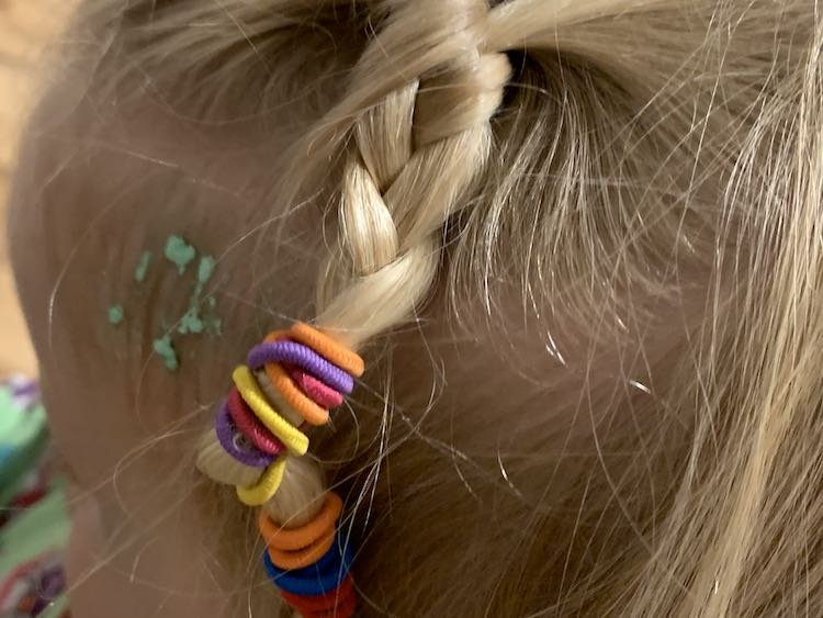I swept some of Zoey's hair back into a small French braid then continued it down into a braid. I ended it with all the ponytail ties so there's a rainbow of color at the end. Behind the braid is a section of green flakes in her baby hairs.