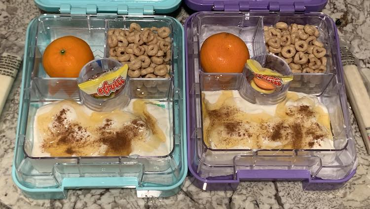 Used their new snack-sized bento boxes to make a yogurt parfait. Both opened boxes are next to each other filled up with a simple and easy lunch.