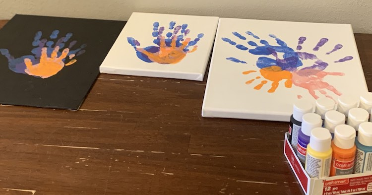 The canvases are placed side-by-side with the small one in the center and the larger ones on either side. In the foreground you can see the pack of acrylic paint I used.