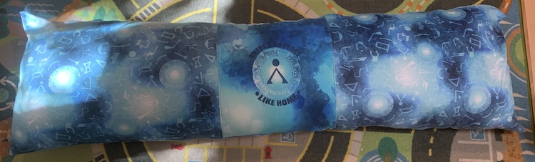 Closeup of the long Stargate pillow. The light from the window is shining on the left side causing the one stargate to light up more compared to the others.