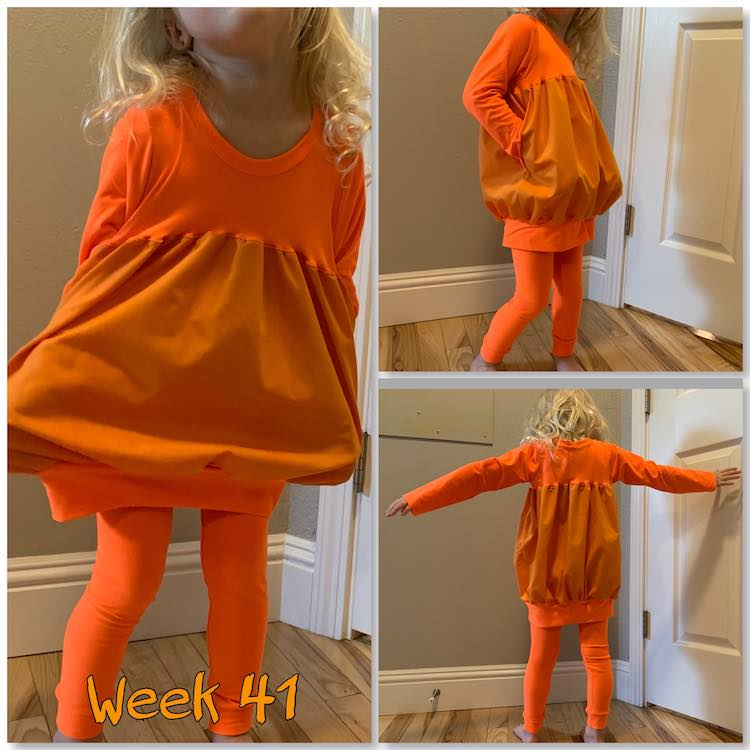 "Image is again a collage of three photos. This time the large image is on the left and the two smaller ones on the right. From left, across, and down it shows the outfit pulled out at the sides as Zoey's hands are in the pockets, then an angled one with her hands in the pockets again, and finally a back view with her arms outstretched. At the bottom on the left is says ""week 41"" in orange."