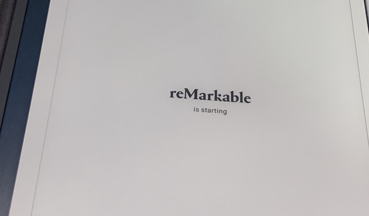 "Image shows a white screened reMarkable with the screen reading ""reMarkable is starting""."