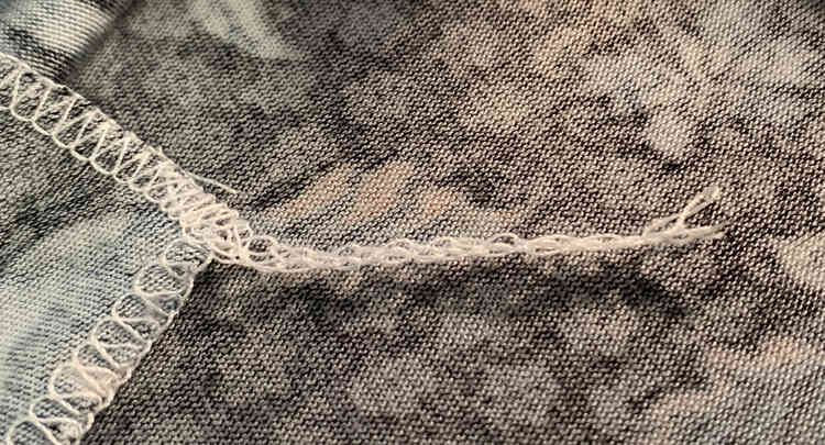 Image shows the same tail as above but this one is shorter with all the threads ending at the same spot.