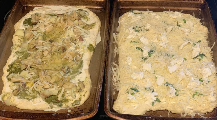 Image shows two different cookie sheets side by side with two different sets of toppings on it. Cold and waiting for the oven.