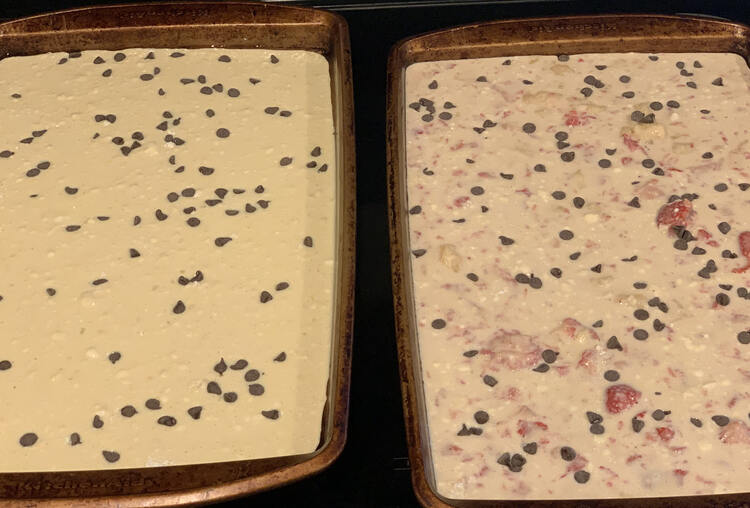 Image on the left is plain unbaked pancake batter with chocolate chips on top. To the right there's also chocolate chips but the batter is tinted pink with lumps of pink strawberries inside.