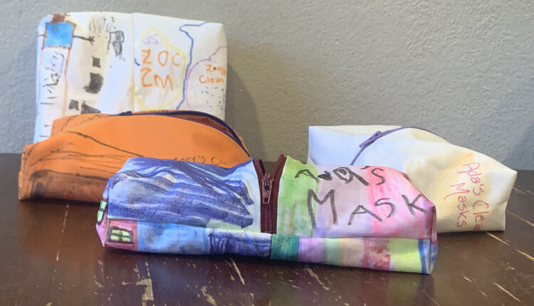 Image shows four colorful zippered pouches laid out on a table.