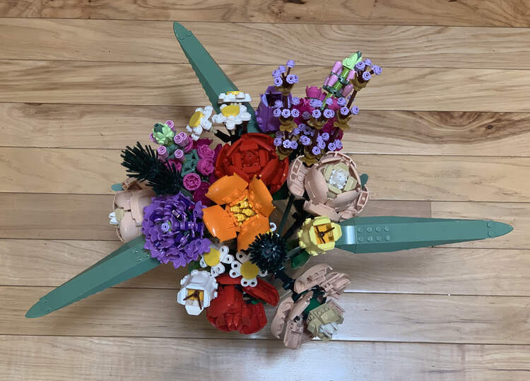 Image is taken from above looking down at the full bouquet set on a wooden floor.