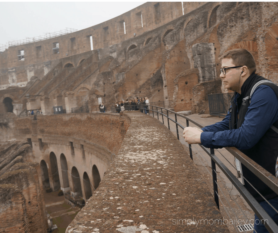 listening to audioguides at the colosseum in Rome, Italy