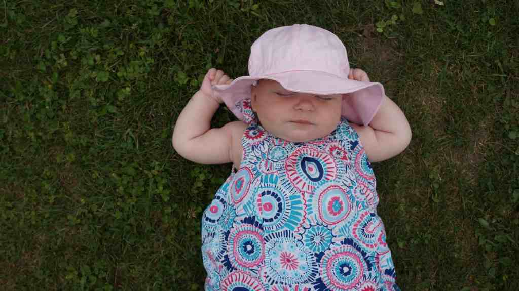 Twinklebelle Gro-with-me sunhat on a baby