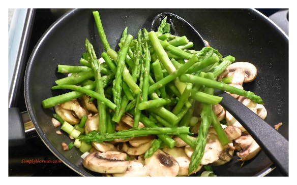 Add blanched asparagus to the skilelt