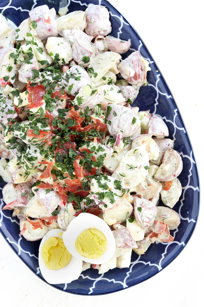Healthy-ish Roasted Potato Salad is loaded with the perfect combination of crispy pancetta, creamy eggs, fresh herbs and a tangy greek yogurt dressing.