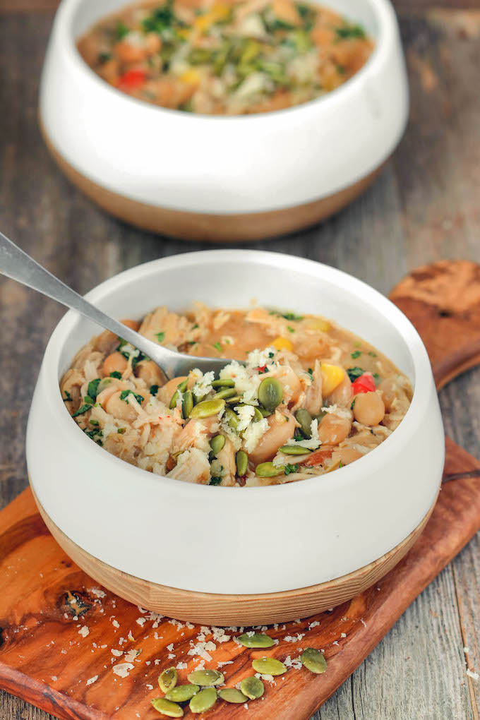 Hearty, 1-bowl White Chicken Chili has seasoned chicken, white beans, tons veggies and a creamy cornmeal base. Perfect served with a shredded Vermont White Cheddar, guacamole and corn chips.