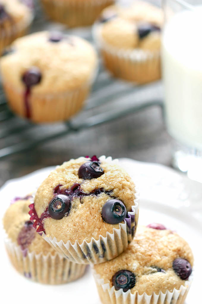 These whole-grain blueberry muffins are made with wholesome whole wheat and almond flours, fresh blueberries, and pure maple syrup.