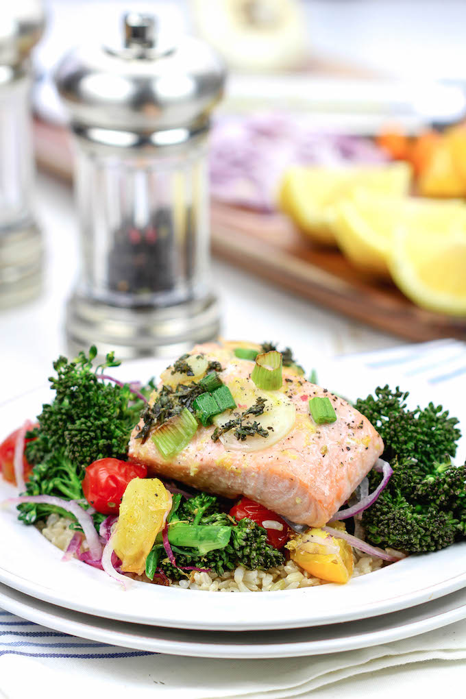 Lemon Herb Salmon El Papillote . A fast and healthy dinner loaded with fresh veggies and nutrient dense salmon. It cooks in it's own parchment paper pouch, so no dishes!
