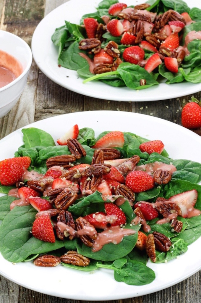 A simple spinach salad with loads of crunchy sweet pecans and fresh juicy strawberries, all dressed in a homemade tangy-sweet creamy vegan dressing.