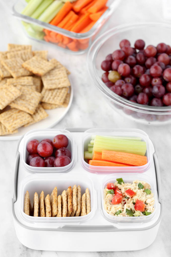 Healthy Chicken Salad.. all of the flavor, less of the mayo! Seasoned chicken, fresh herbs and a simple yogurt-based dressing. Paired with whole-grain crackers, fresh grapes and crispy veggie sticks.