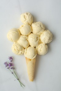 several scoops of Honey Lavender Ice Cream on a marble board with one cone