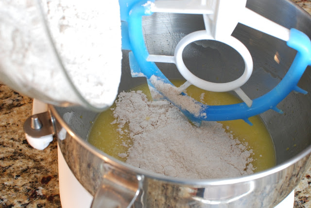 flour added to butter oil mixture in bowl