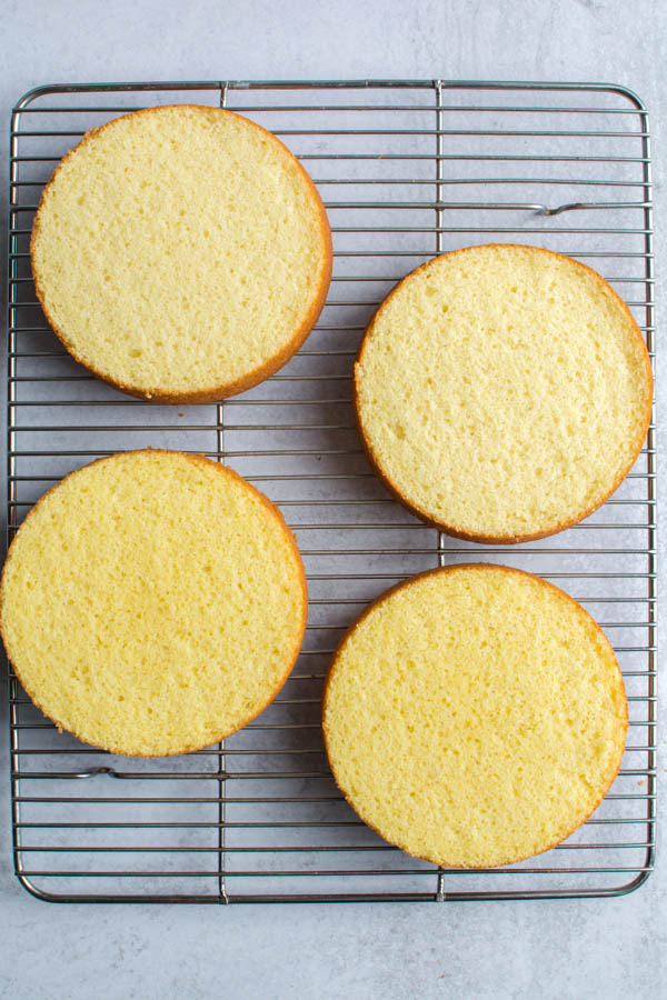 4 cake rounds on cooling rack